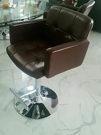 black leather padded rolling armchair Surrey, V3S 2E1