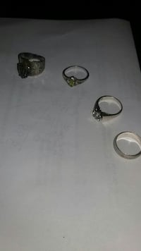4 sterling silver rings size vary  Greenville, 24440