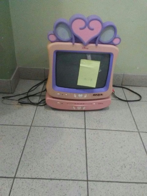 pink and purple Disney tv and DVD player
