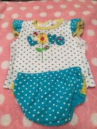 baby's white and blue polka-dot onesie 1483 mi
