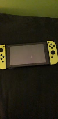 White nintendo switch with game controller Silver Spring, 20906