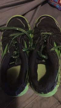 Pair of black-and-green nike running shoes Danville, 40422