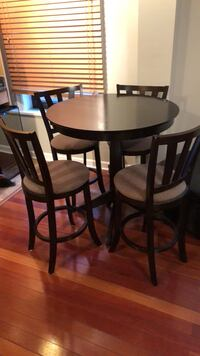 Round brown wooden table with four chairs dining set Washington, 20009