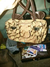 brown and white Coach monogram tote bag