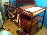 Crib with changing table and storage drawers. Gretna