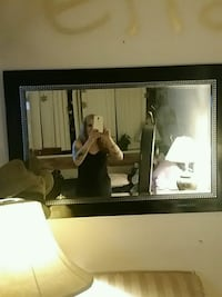 brown wooden framed wall mirror Vancouver, V5R 5L6