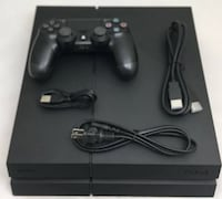 black Sony PS4 console with controller Houston