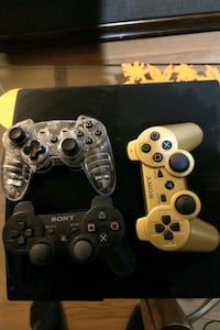 Sony PS3 slim console with two controllers