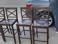 4 wooden bar stools. limited use. $35 a piece or $125 for all 4