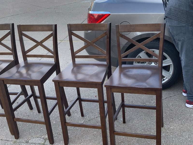 4 wooden bar stools. limited use. $35 a piece or $125 for all 4 0d8481b3-8cc4-4e20-819d-580e54e7622c