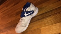 pair of white-and-blue Nike running shoes New York, 11367