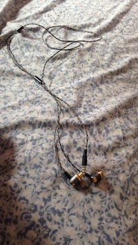 brown and black corded in-ear canalbuds
