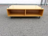 Glass top coffee table with storage on wheels  Las Vegas, 89117