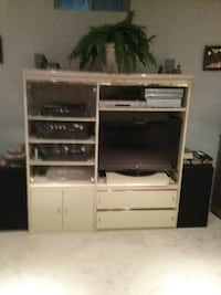 white and black wooden TV hutch null