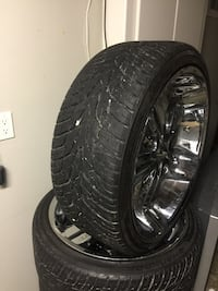 chrome-colored multi-spoke vehicle wheel with tire