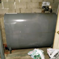 Oil tank and 1/2 tank oil.Must be removed from bas Burtts Corner, E6L 2C7
