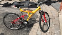 red and black full suspension mountain bike Aurora, L4G 6M9