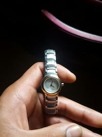 round white analog watch with silver link 50 km