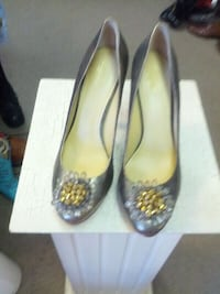 pair of yellow leather peep-toe pumps Myrtle Beach, 29577