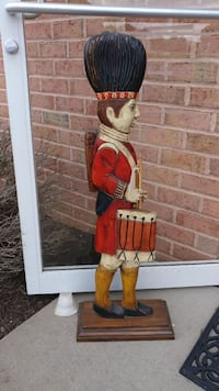 soldier playing instrument wooden sculpture