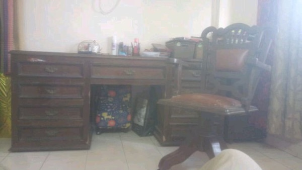 Brown wooden table with good storing capacity