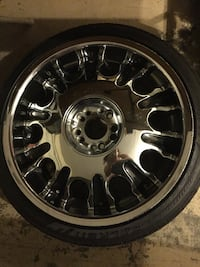 chrome multi-spoke car-wheel with tire