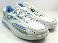pair of white-and-blue Nike running shoes MONTREAL