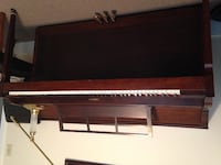 brown wooden framed upright piano
