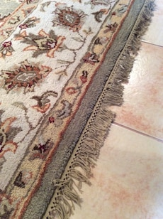 White, brown, and red floral area rug