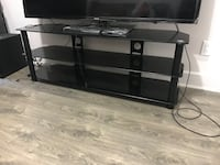 Black brand new glass tv stand with 2 additional bottom shelves . Got this 2 mo the ago , brand new comes with sits original box , yet I 've decided to put the tv in the wall . So it must go .... so silly offers please ! Thks not too desperate for some ch Montréal, H4B 1N3