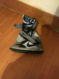 pair of gray-and-white Nike high-top sneakers Flint