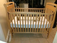 Light wood baby crib