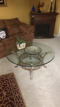 Round glass top table with black metal base