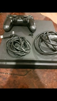 black Sony PS4 console with controller Ottawa, K1J 8T9