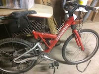Red cannondale full-suspension bicycle