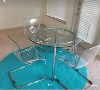 Glass dining table with 4 acrylic chairs  Houston, 77006