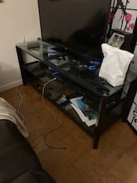 Black wooden framed glass top table//solid entertainment   Norwood, 02062