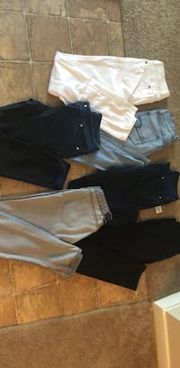 two pairs of black and blue denim jeans Houston, 77072