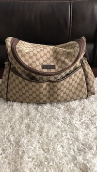 Brown and black gucci monogram Diaper bag good condition