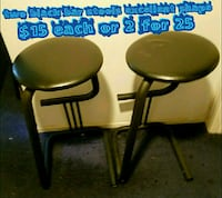 two brown wooden framed black leather padded chairs Las Vegas, 89169