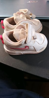 size 4 Nikes girl shoes needs a  cleaning $10. Cranston, 02910