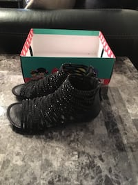 pair of black gladiator shoes with box