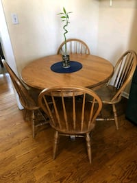 round brown wooden table with four windsor chairs Chicago, 60641