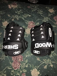 pair of black Sher-wood PMP gloves