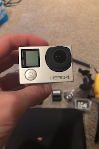 GoPro Hero 4 Silver with Case, Mounts, and a 32 GB Micro SD INCLUDED!!