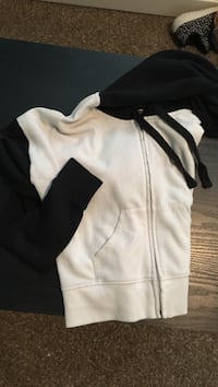 white and black zip-up hoodie