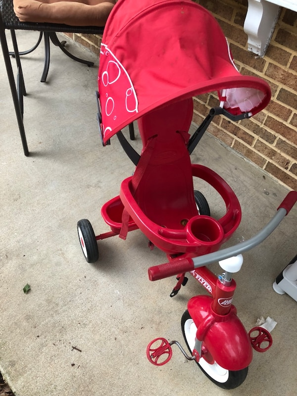 toddler's red and black push trike