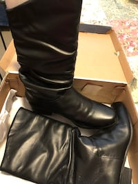 pair of black leather stacked heel extended-calf boots