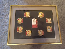 Coca Cola collector pins in frame