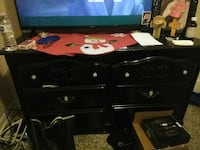 black wooden 6-drawer chest and black flat screen television